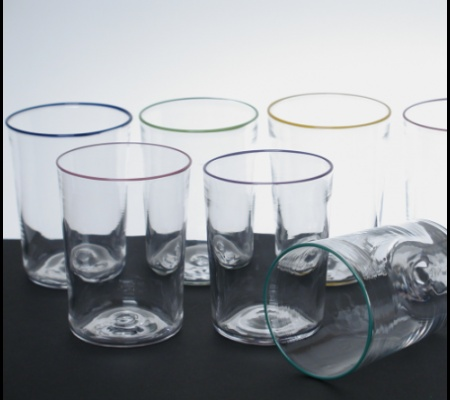 Seven glasses with subtle-colored rims of various colors.
